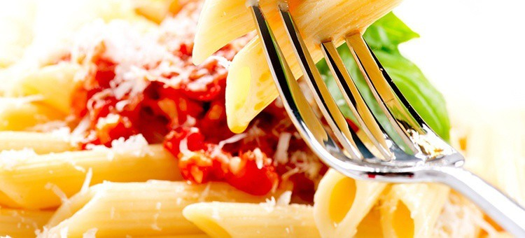 Penne pasta dish with sauce.