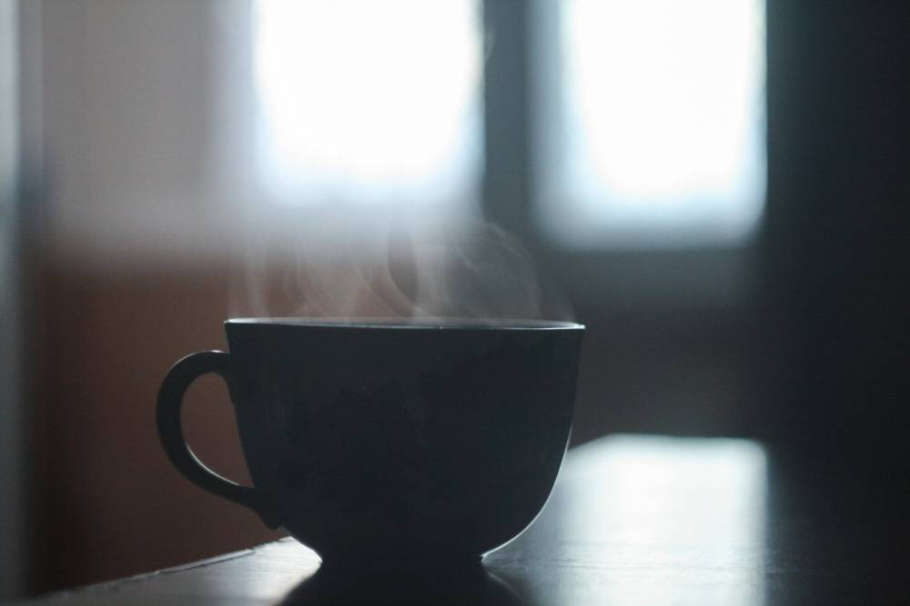 A cup of hot coffee.