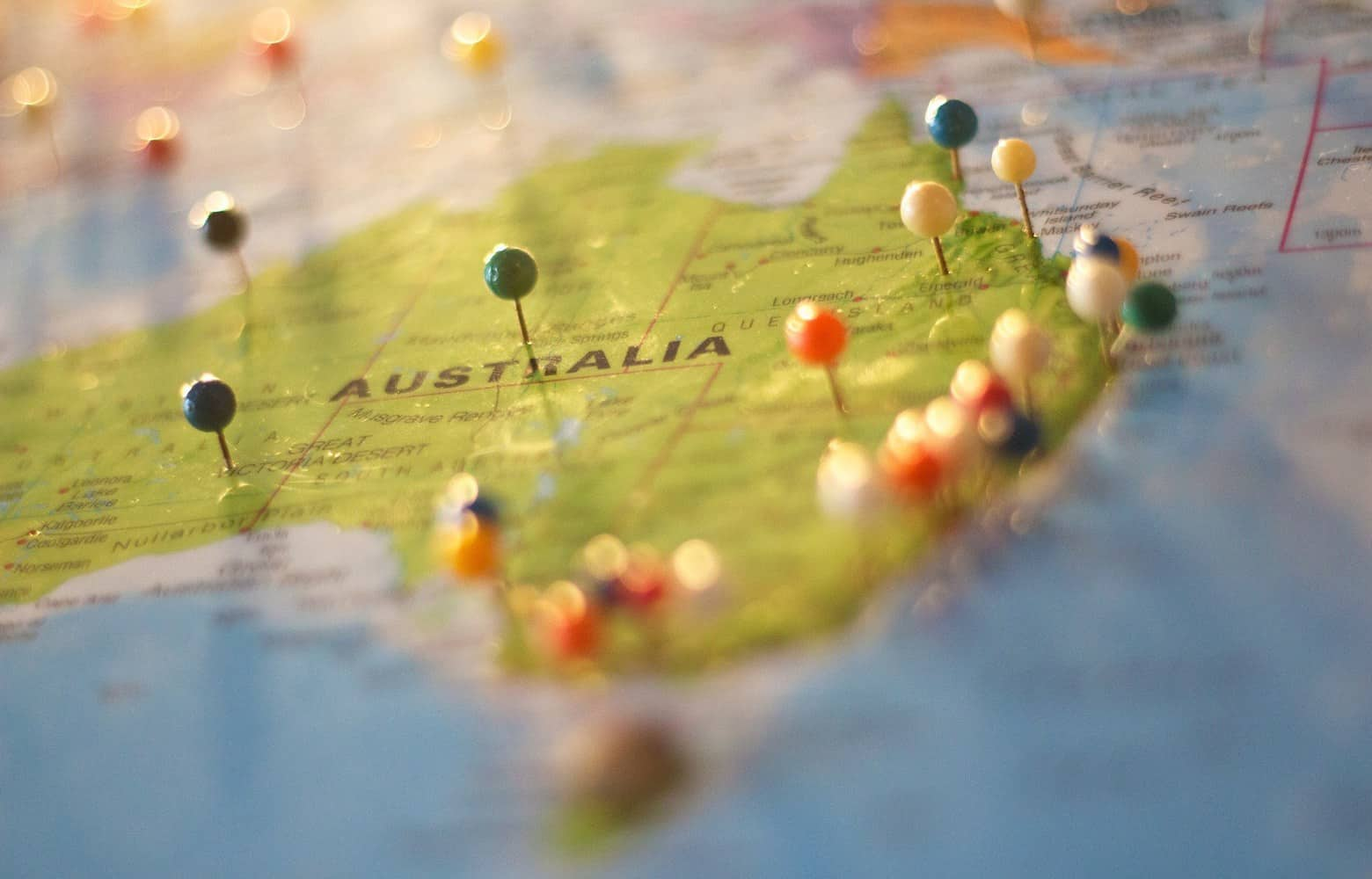 Part of a world map showing Australia with pins.