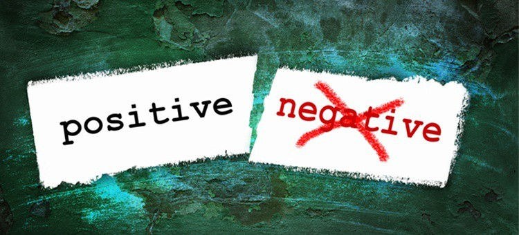 The words positive and negative, with 'negative' being crossed out in red.