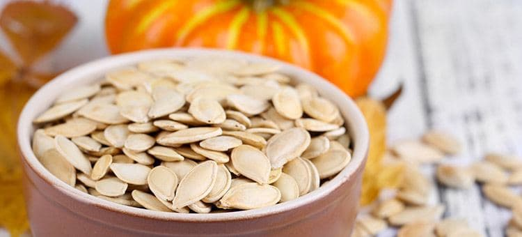 A bowl of pumpkin seeds.