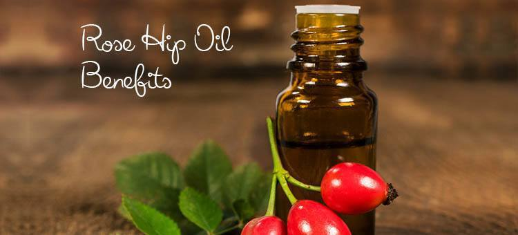 "A smal lbottle of rose hip oil with the fruit next to it with the title ""Rose Hip Oil Benefits"""