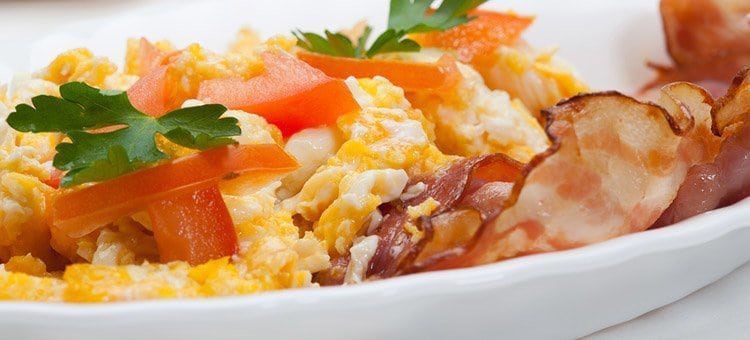 Scrambled eggs with bacon and tomatoes.