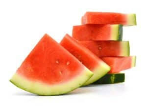 Slices of watermelon stacked on top of each other.