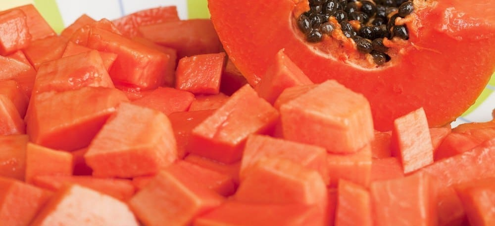 Papaya cubes and a halved papaya.