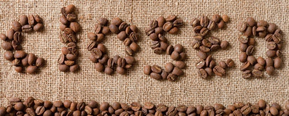 """The phrase """"closed"""" made up of coffee beans."""