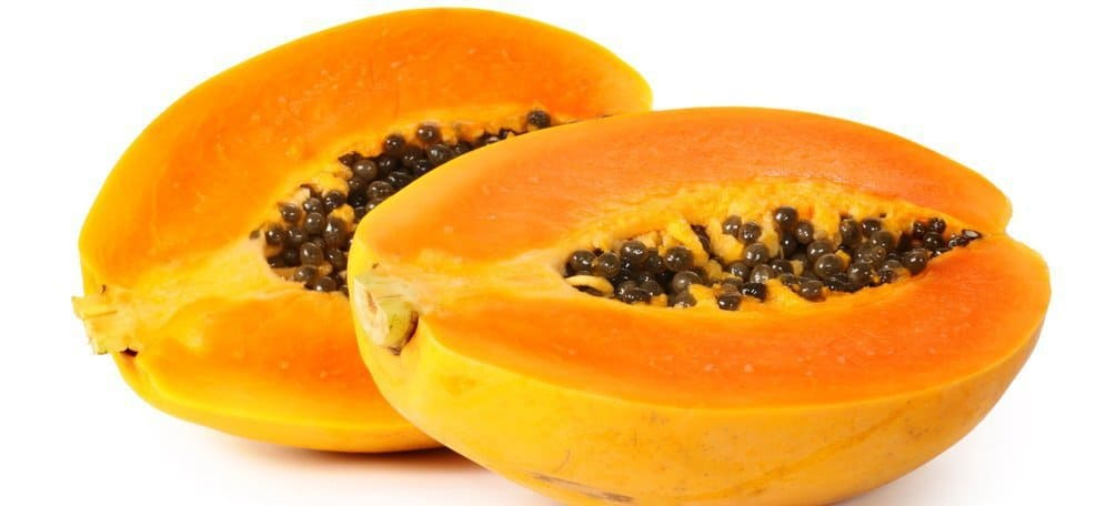A halved papaya with the seeds showing.