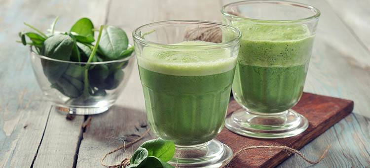 Glasses of green spinach smoothie.