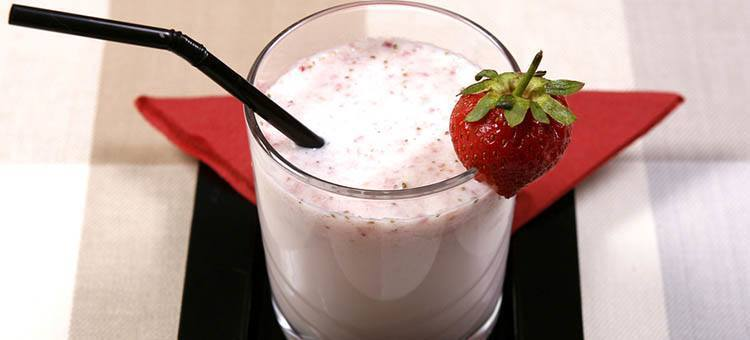 A glass of strawberry smoothie.