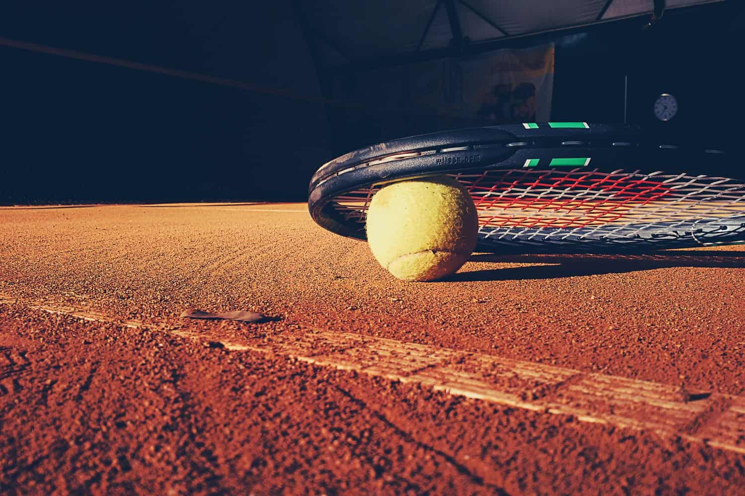 A tennis ball on a court.