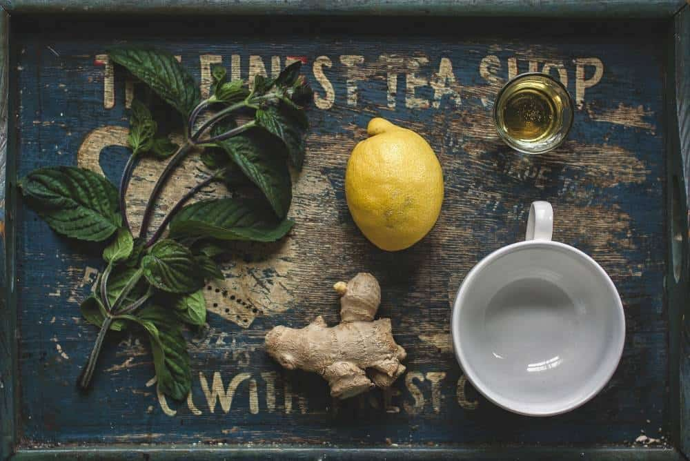 Lemon, ginger and a tea cup.