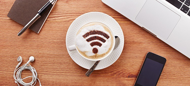 The WiFi symbol made up of coffee cream in a cup of coffee.
