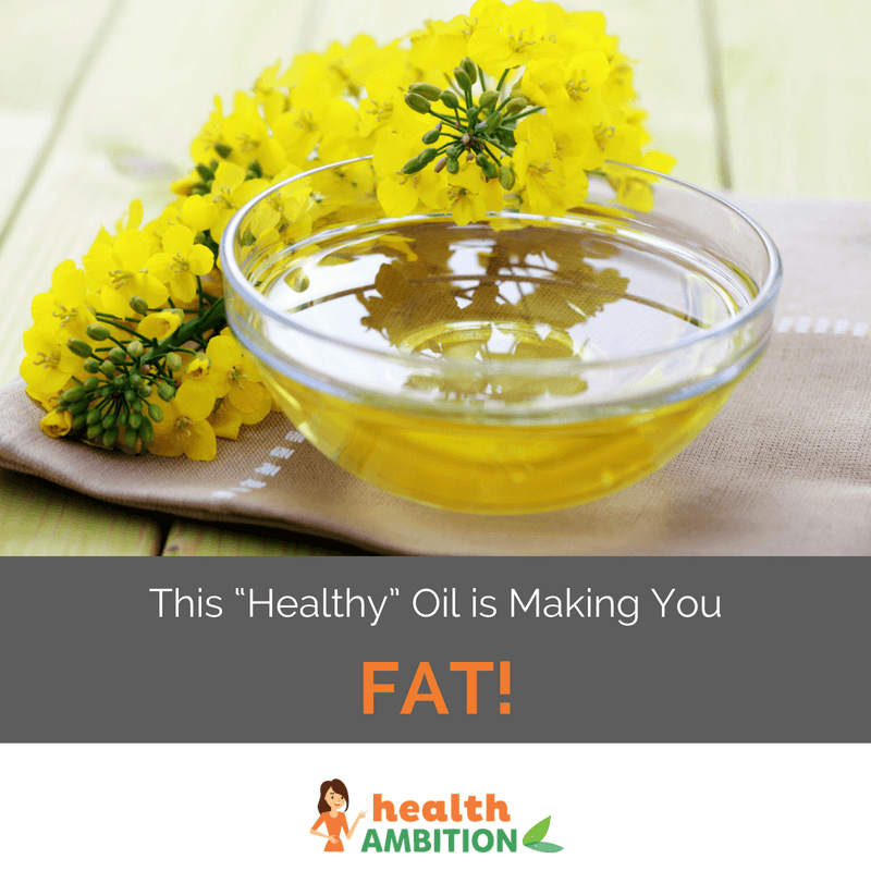 """A cup of canola oil next to the flower with the title """"This """"Healthy"""" Oil is Making You Fat!"""""""