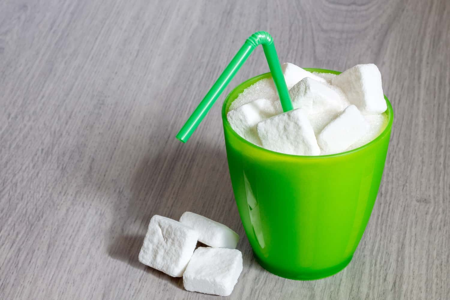 A cup of sugar cubes.