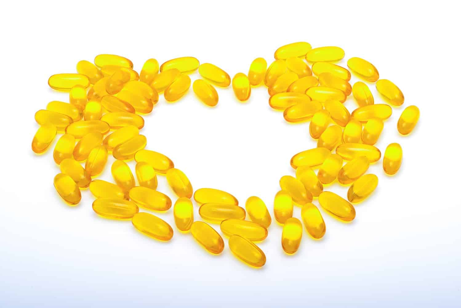 Fish oil capsules forming the shape of a heart.