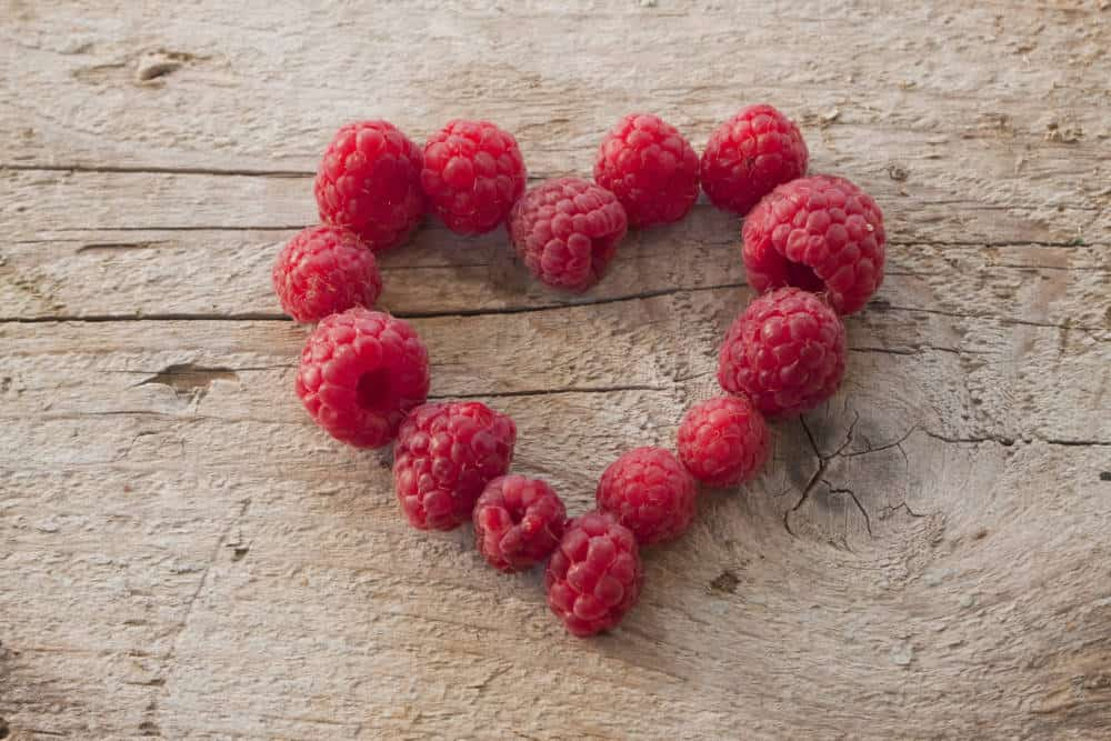 Raspberries in a heart shape.