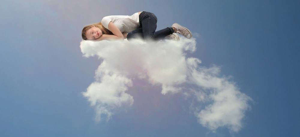 A person sleeping on a cloud.