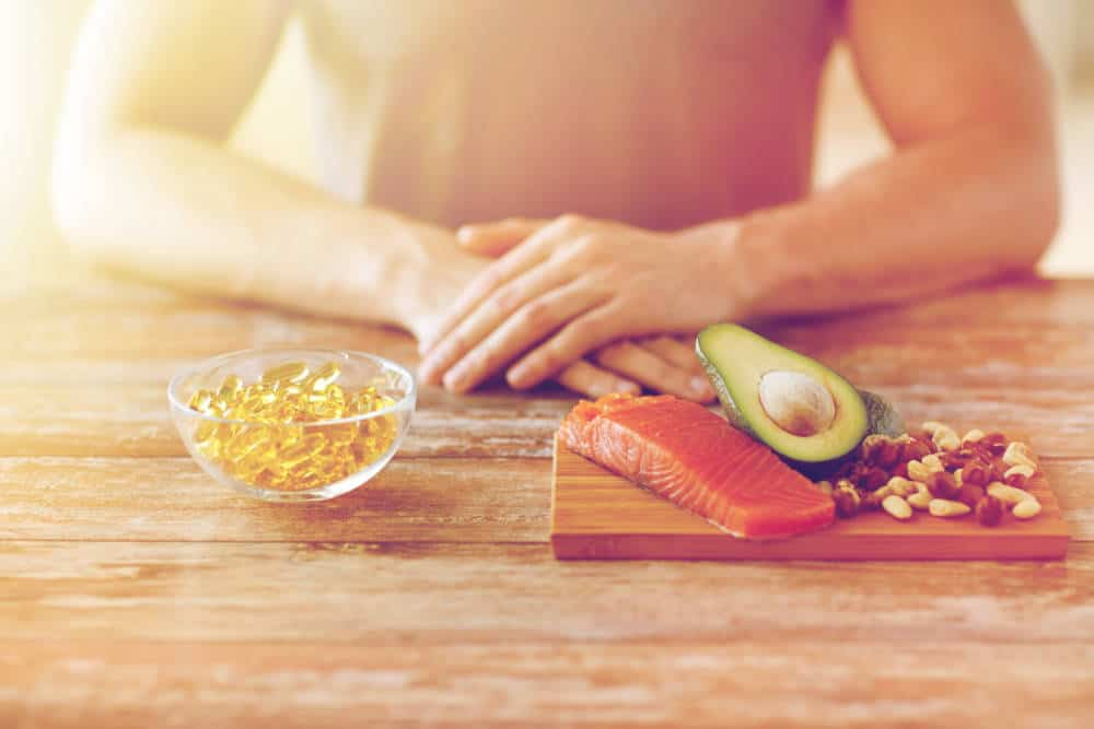 Fish oil capsules and avocados and fish.