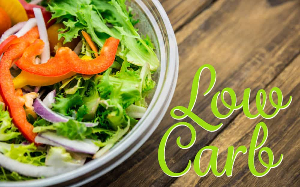 low carb against healthy bowl of salad on table