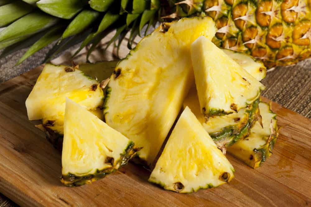 Fresh Yellow Organic Pineapple cut into slices