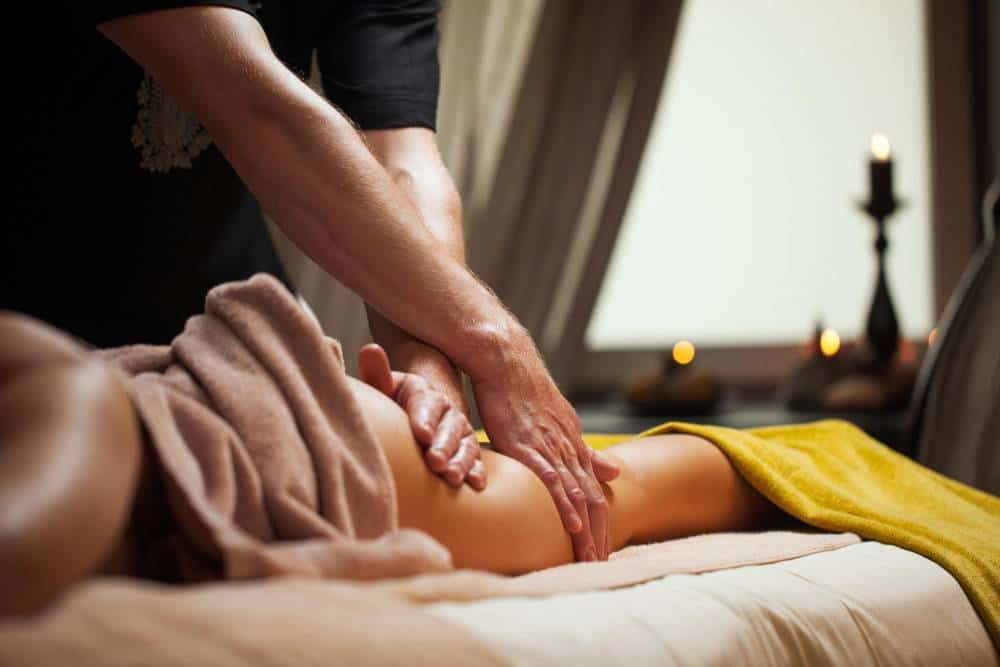 A woman receiving a massage.