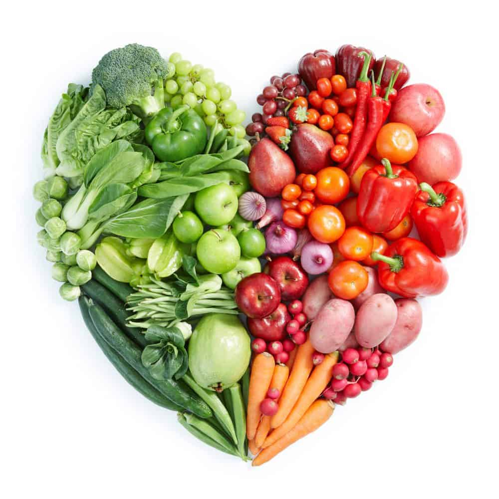 A heart shape made of vegetables and fruit.