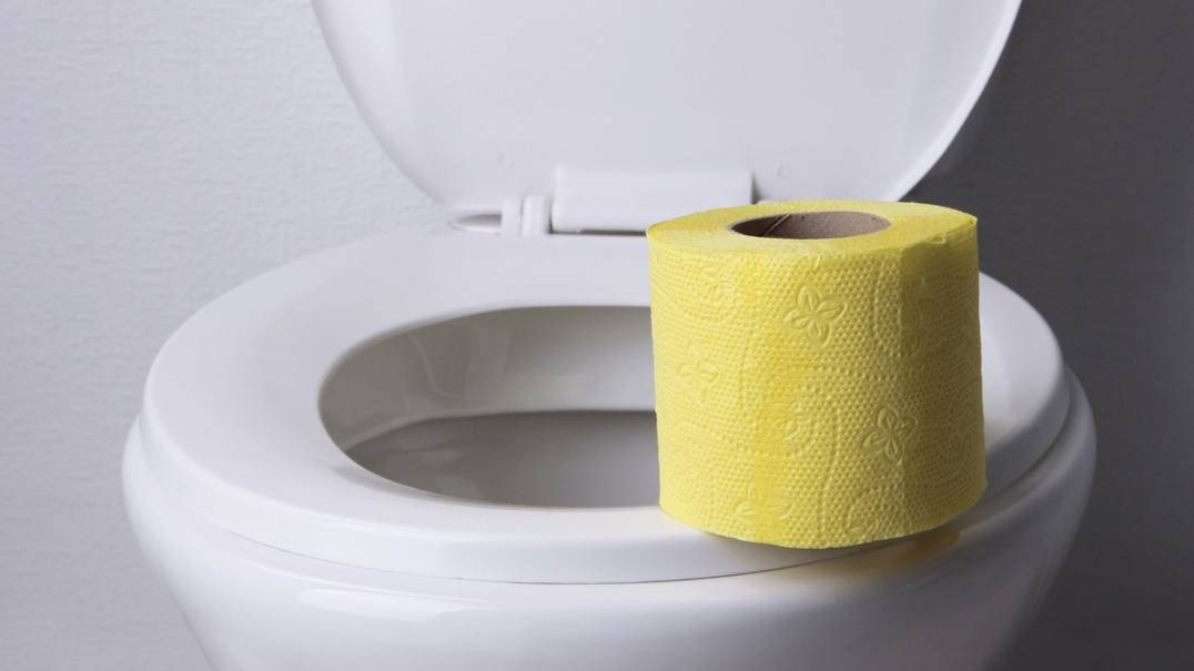 A toilet with toilet paper.