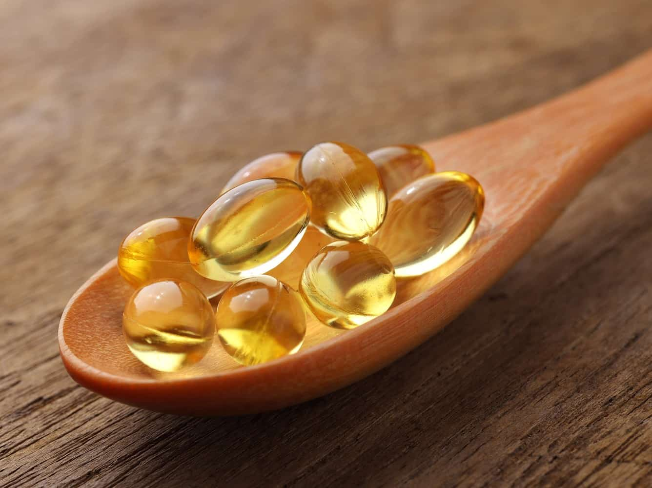 A spoonful of fish oil capsules.