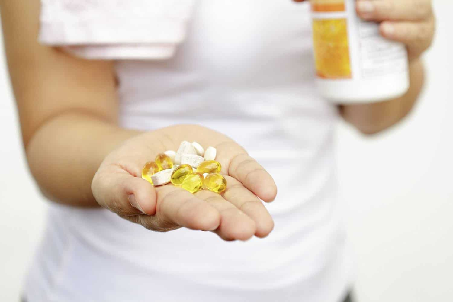 Capsules in a woman's hand..