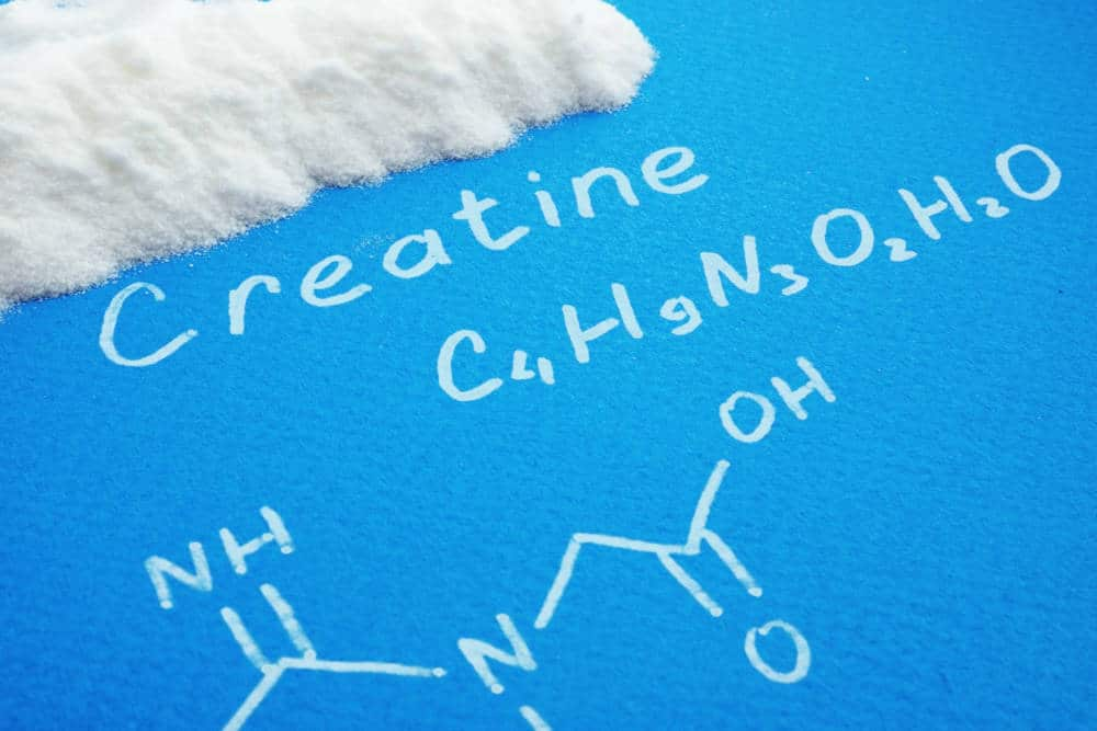 Creatine molecule drawn on a blue surface.