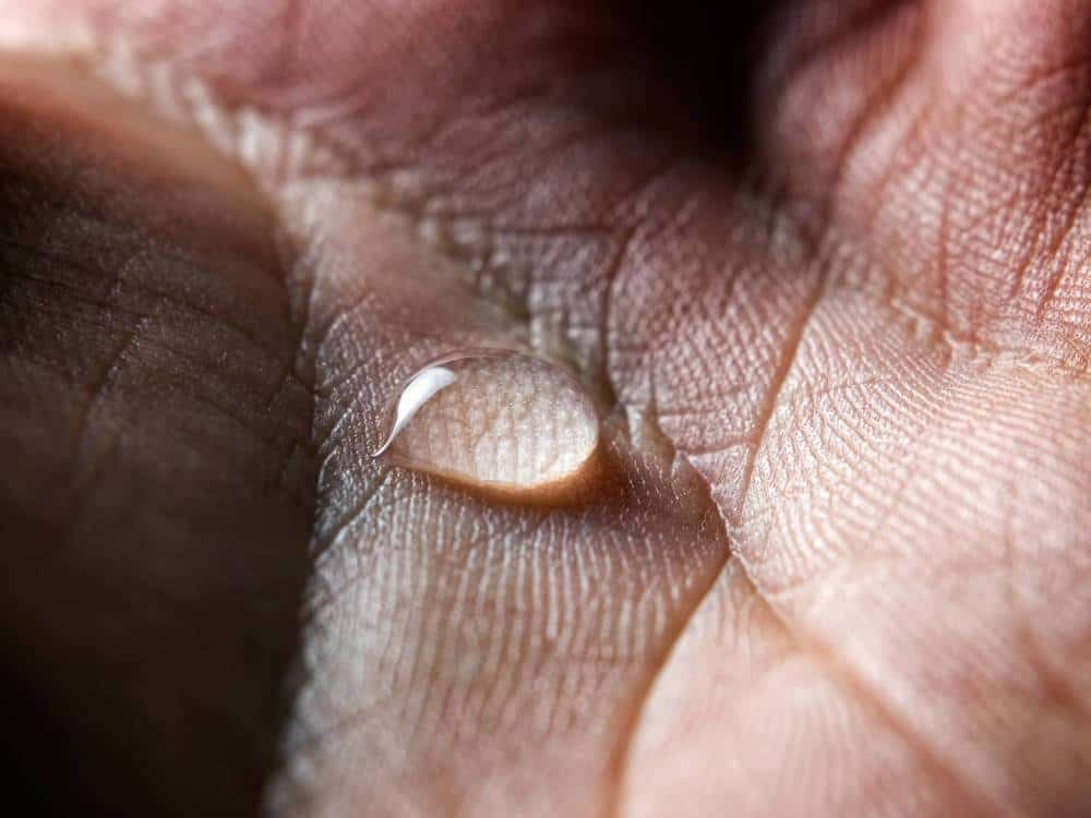A drop of sweat on a hand.
