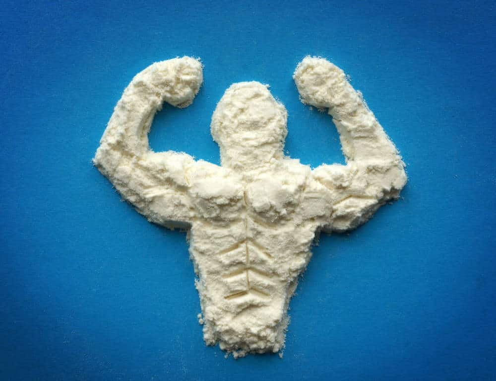Protein powder forming a muscular man.