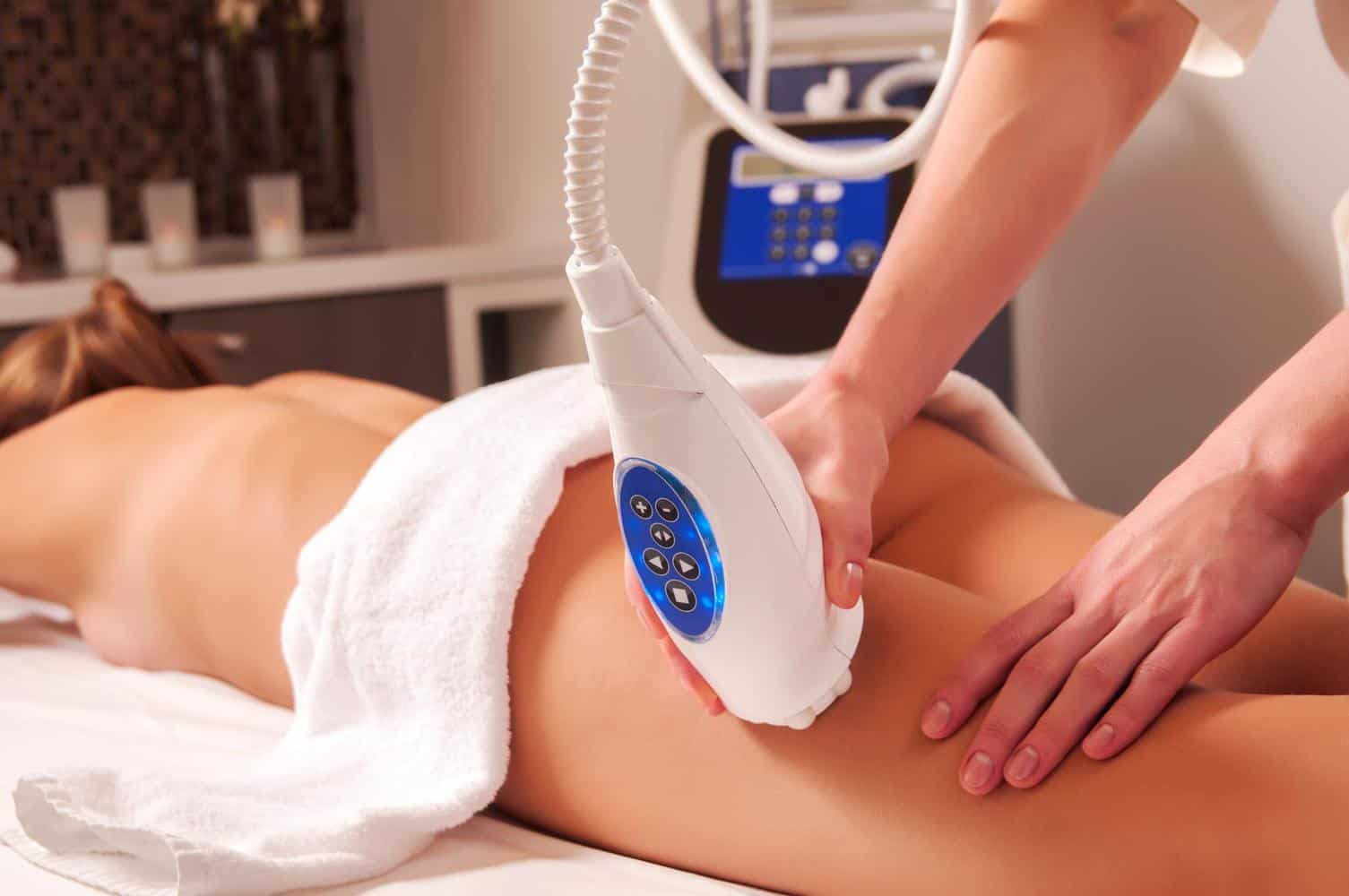 Woman being massaged with a cellulite massager.