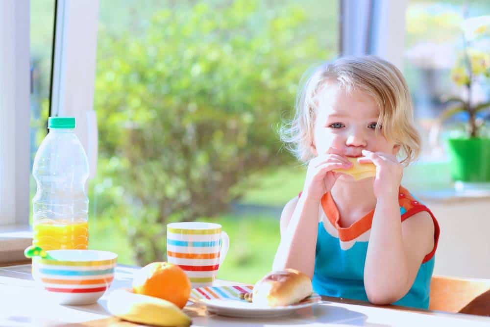 A girl enjoying breakfast.