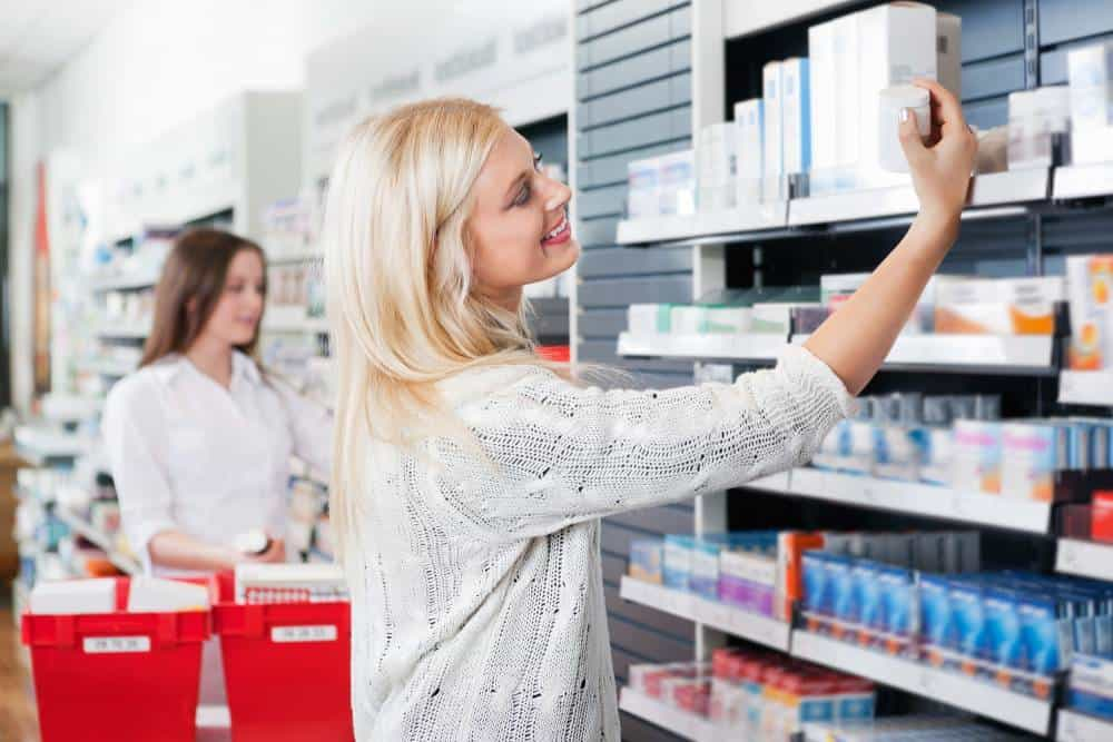 A woman shopping at a pharmacy.