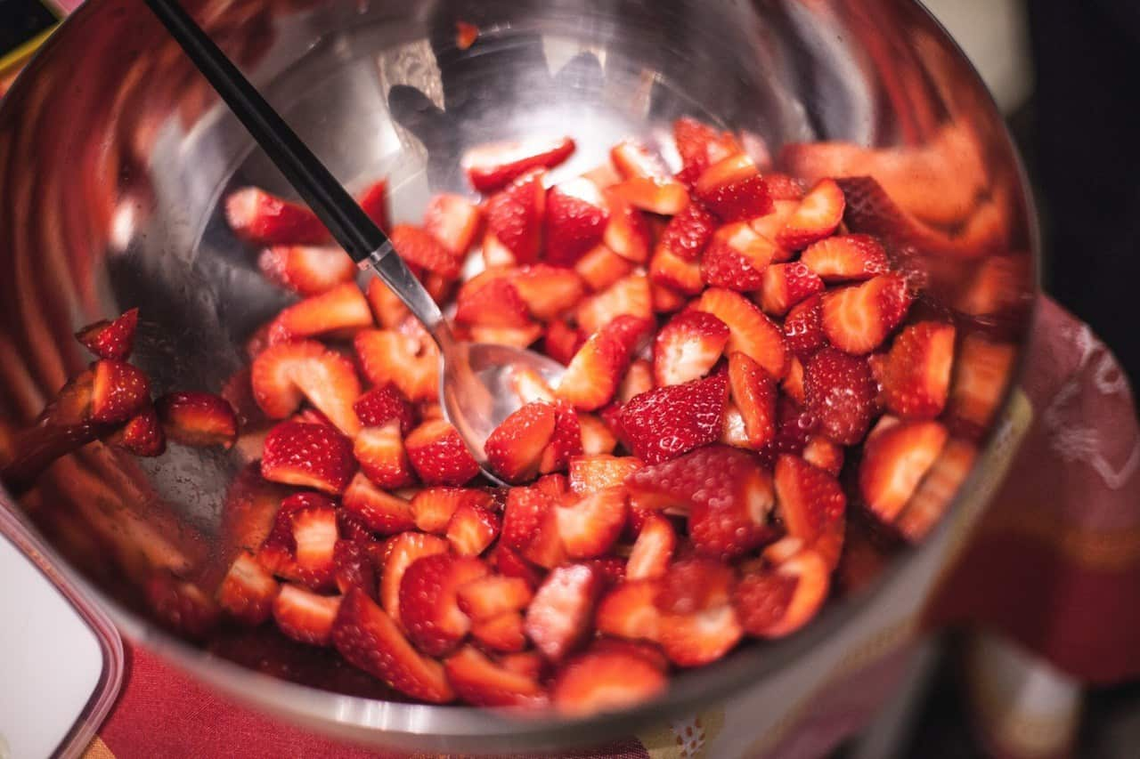 A bowl of sliced strawberries.