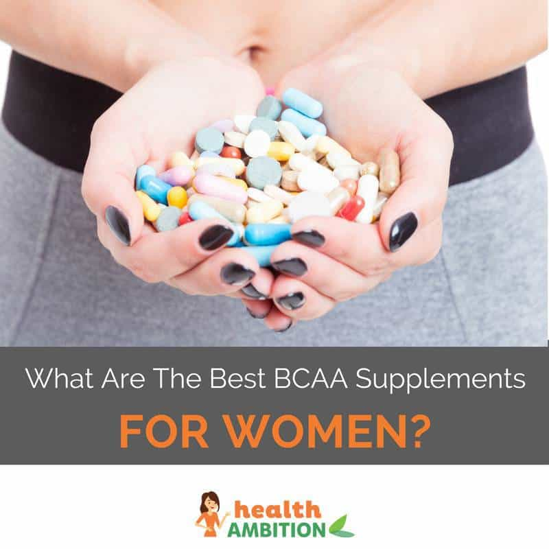 "A person holding a large handful of tablets and capsules with the title ""What Are The Best BCAA Supplements For Women?"""