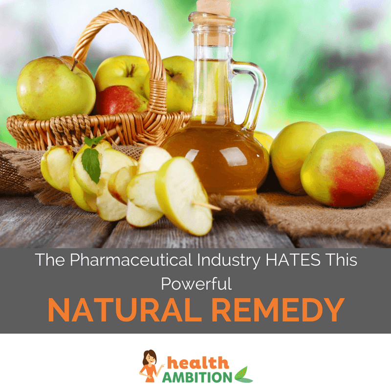 """Apple cider vinegar surrounded by apples with the title """"The Pharmaceutical Industry HATES This Powerful Natural Remedy"""""""