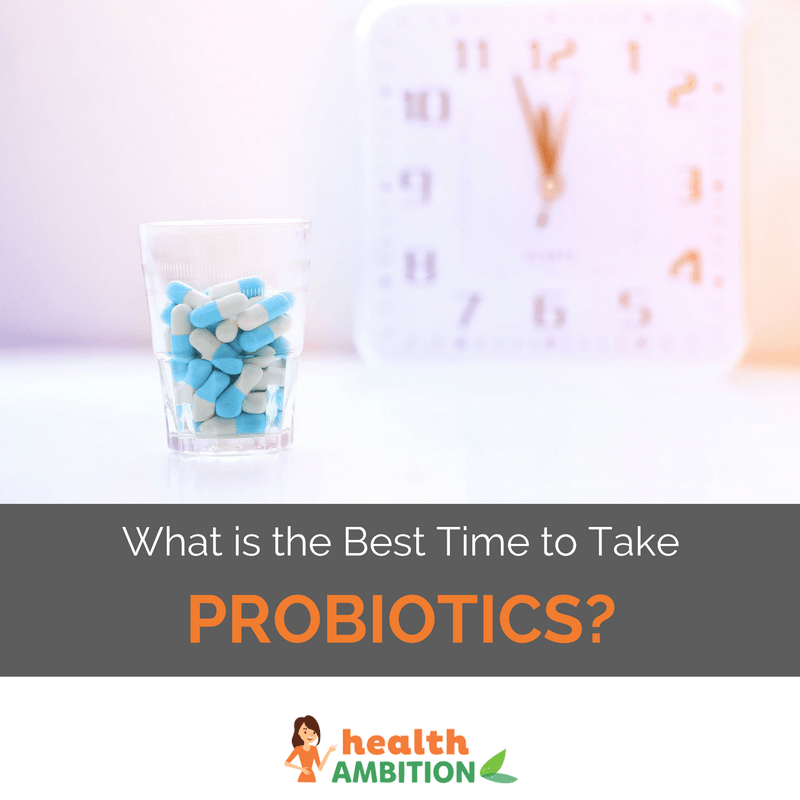 "A glass of capsules in front of a clock with the title ""What is the Best Time to Take Probiotics?"""