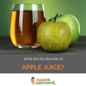 "Glass of apple juice next to apple with the title ""What Are the Benefits of Apple Juice?"""