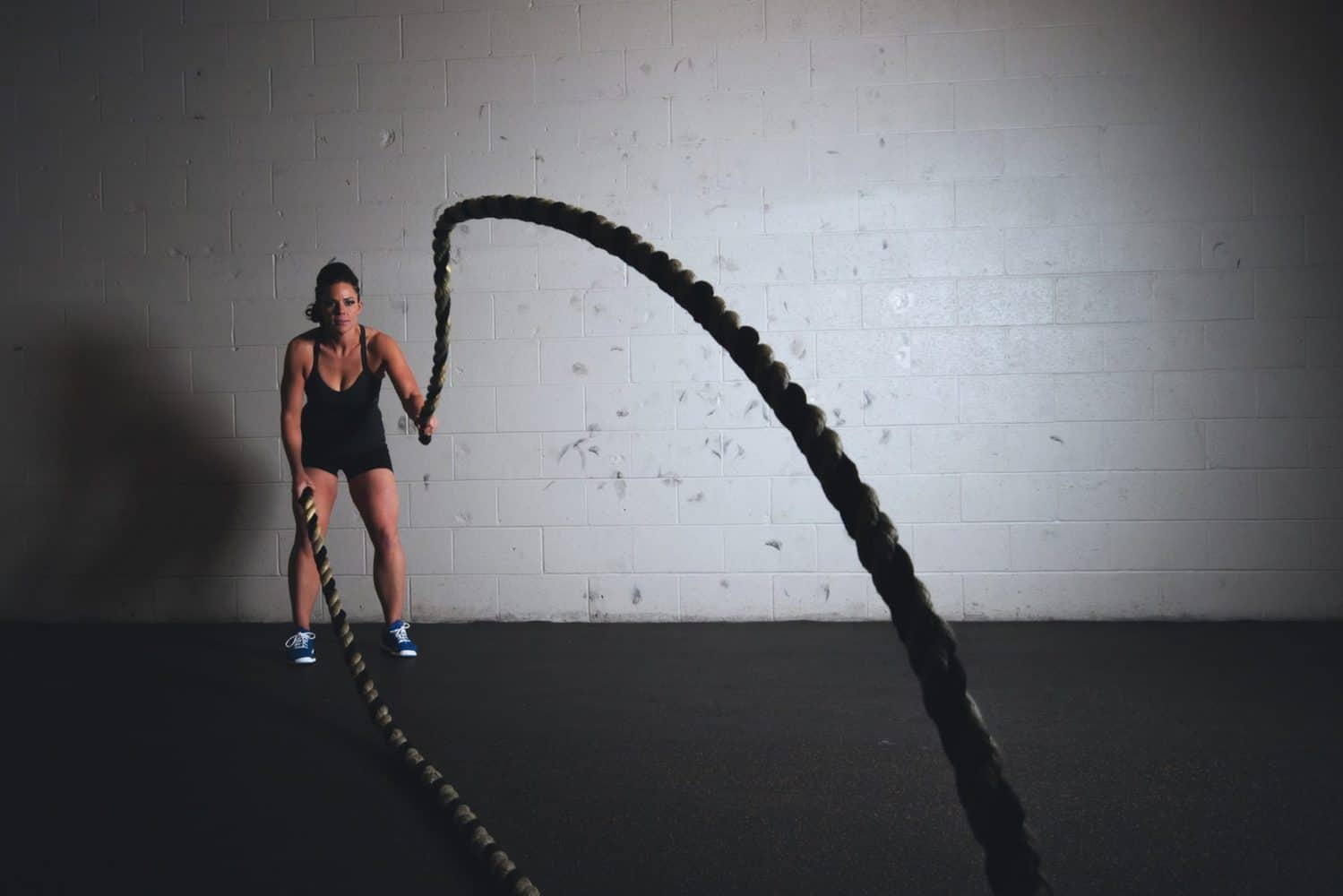A woman using ropes for workout.