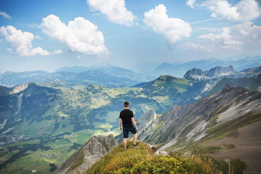 A man looking at a huge valley.