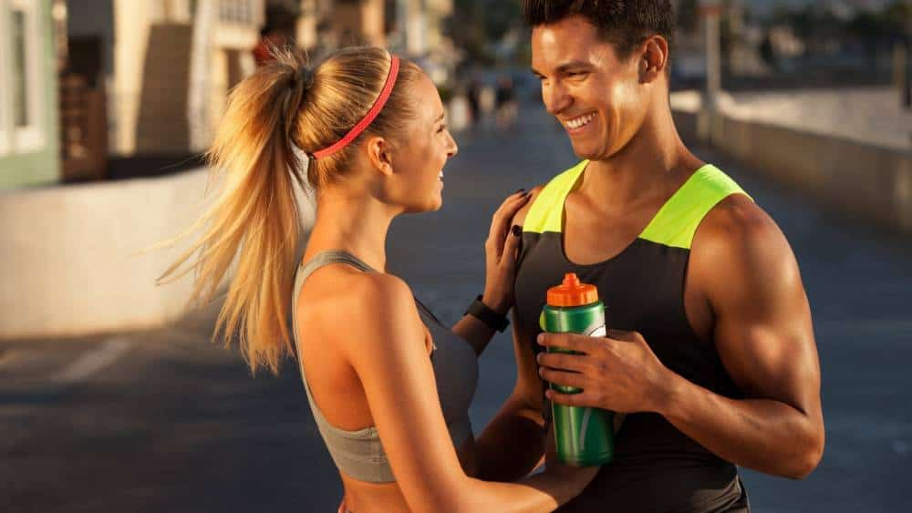 A couple smiling at each other during exercise.