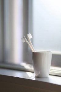Toothbrushes in a mug.