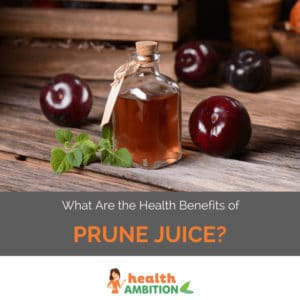 "A bottle of prune juice with prunes with the title ""What Are the Health Benefits of Prune Juice?"""