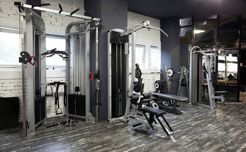 Weight benches, weights, pull up bars and other exercise machines in the best home gym.