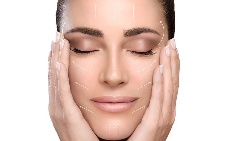Woman applying the oil cleansing method for face skin and acne.