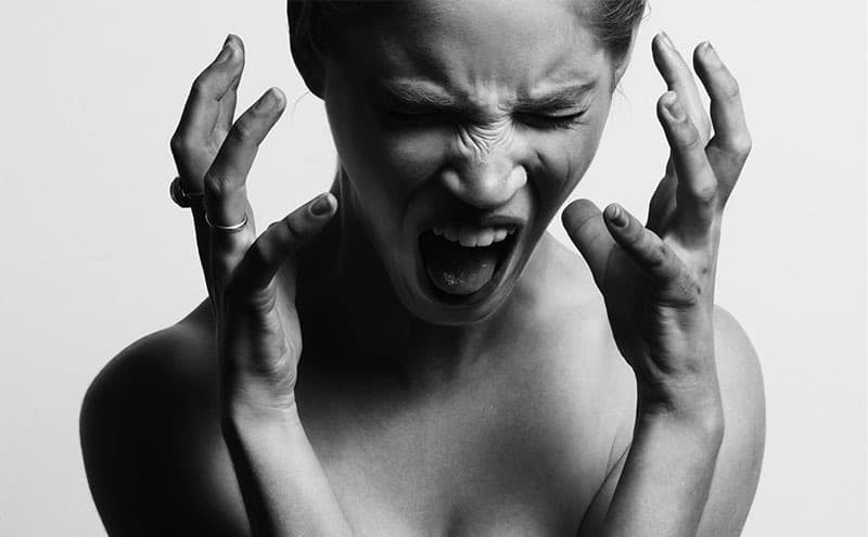 Woman being angry after finding out that stress does cause grey hair.