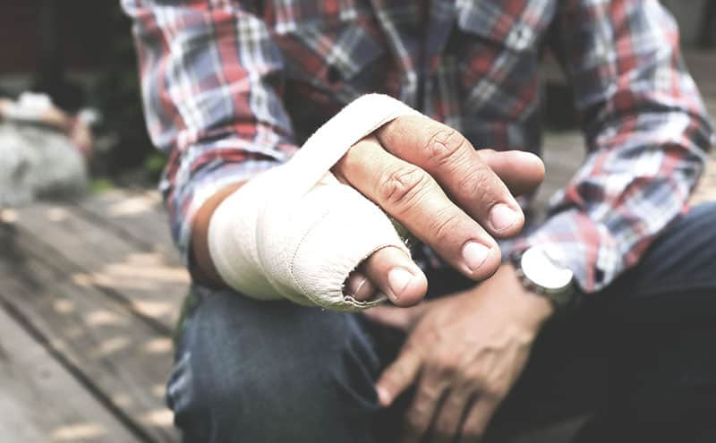 A man with finger splints for broken finger injuries.