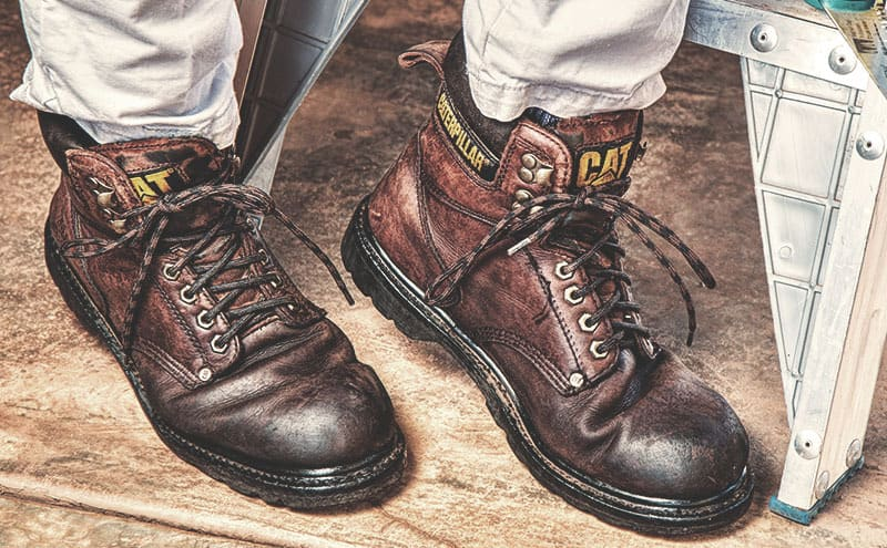 A pair of working boots made much more comfortable by the best insoles for work boots.